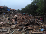 Kampung Pulo Ciliwung riverbank after twelve houses are demolished at the end of the day on 20 August 2015. Bulldozers are expected to come back the next day. Photo: Azas Tigor Nainggolan.