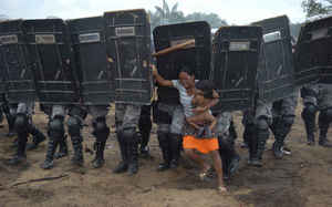 Woman tries to stop forced eviction of her people, Manaus, Brazil, March 10 (General News, Luis Vasconcelos, A Critica - Zuma Press, 2008)